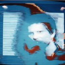 Frame from the SPK video with close up of Neil Hill.