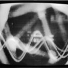Frame from Syntheses: with oscilloscope display of sound and video feedback..