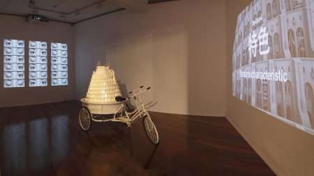 Laurens Tan, Babalogic II, 2009, Video installation: dual channel projection, custom cylindrical sanlunche, CAD ABS Tower Dimensions Variable. (ZhongJian- China & Australia Tour 2009-12)