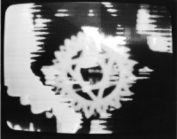 Frame from Syntheses: with computer graphic mandala.